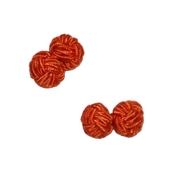 Manschettknopar rund orange-vit